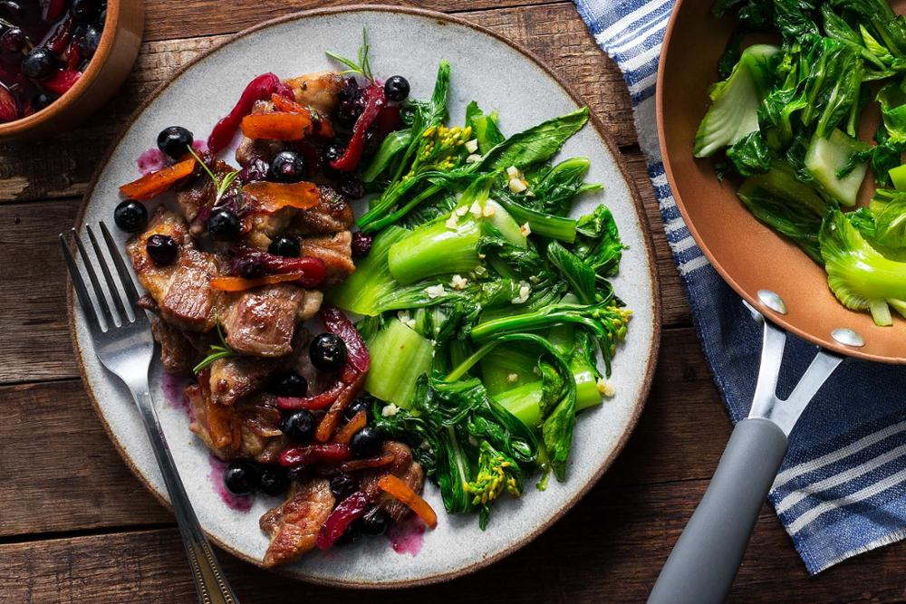 Seared pork with blueberry-apricot sauce and sauteed greens